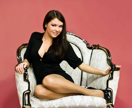 young attractive girl sitting in antique armchair Stock Photo - 6043508
