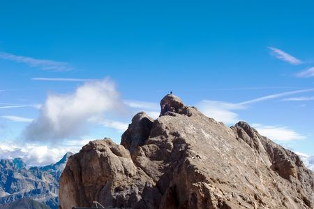 sud tirol: man on the rock, breathtaking view from Marmolada mountain, Northern Italy