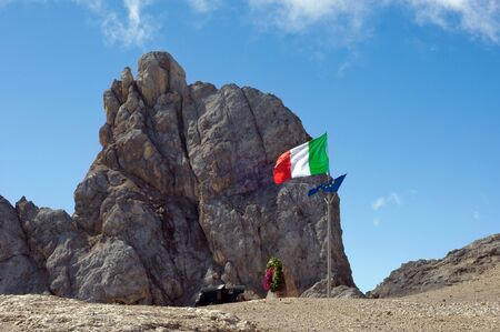 sud tirol: italian flag on Marmolada mountain, Italy, Sud Tirol Stock Photo