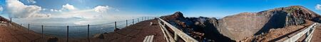 panorama at crater of volcano Vesuvio, seen crater inside and bay of Naples photo