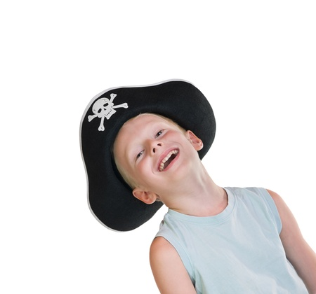 young boy wearing pirate hat, isolated on white background photo
