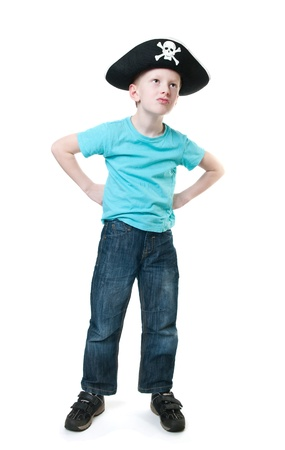 young boy wearing pirate hat, isolated on white photo