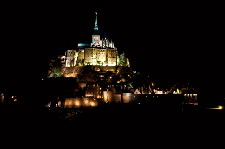 Mont Saint-Michel in the night, illuminated photo