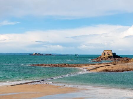 st malo: Low tide in Saint Malo, France  View on beach, mole and fort on island