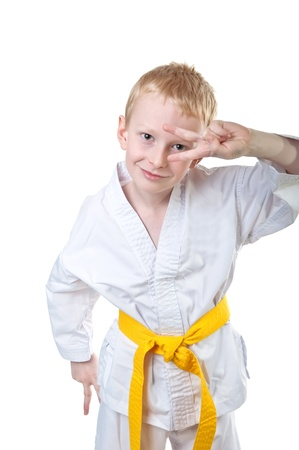 Smiling boy wearing tae kwon do uniform and having fun photo
