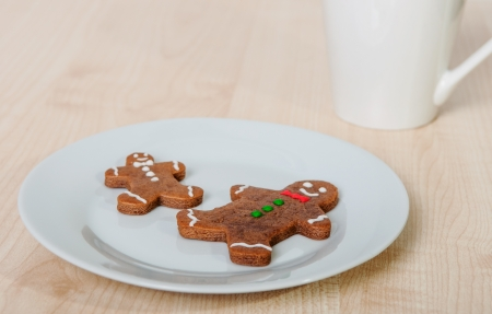 Two gingerbread men cookies on a plate  photo