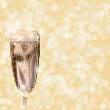 rightly: Glass of champagne on golden background.