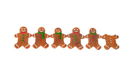 Gingerbread men in a row isolated on white background photo
