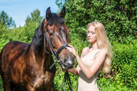 Young pretty girl and a horse photo