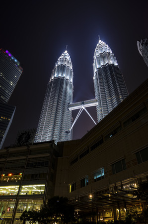 twin tower: KUALA LUMPUR - SEP 18: PETRONAS Twin Towers on SEP 18, 2015 in Kuala Lumpur, Malaysia. It was the tallest building in the world from 1998 to 2004 and remains the tallest twin tower in the world.