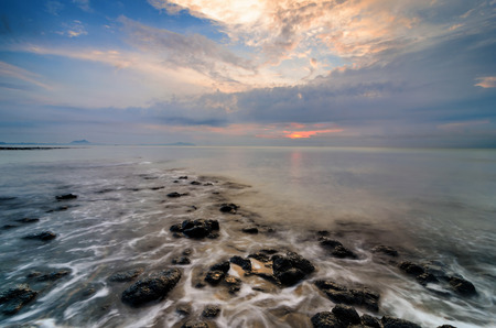 marvelous: Awesome sunrise with marvelous clouds. Slow shutter used to create foamy & hazy effect. Stock Photo
