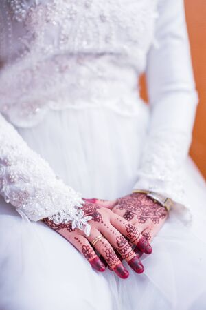 Very beautiful and unique henna paintings are on both hands of the bride.