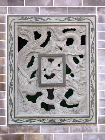 Traditional Chinese ornamental engraved brick window