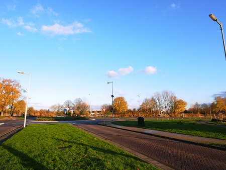 Sub-urban roundabout under the Autumn sky