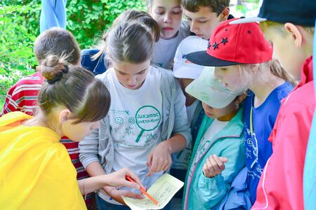 Summer camp for gifted children - children's science city. In the photo, children play a creative game.