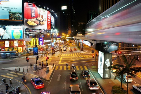 KUALA LUMPUR - JUNE 21: Exterior of BUKIT BINTANG JUNTION on June 21, 2011 in Kuala Lumpur, Malaysia. BUKIT BINTANG JUNTION is the popular destination and colorful at night in Malaysia for local tourist