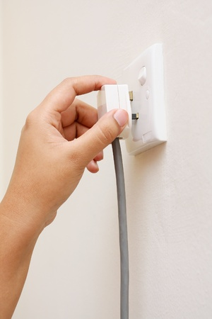 unplugged: hand unplug switch socket outlet in wall