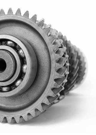 machine part: gear with ball bearing on isolated white background