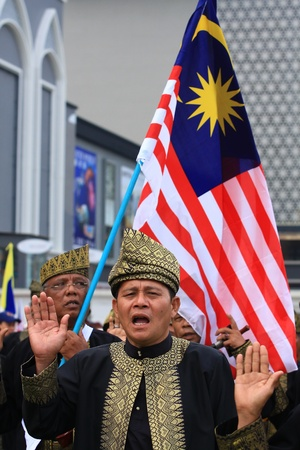 KUALA LUMPUR-SEP 16:Unidentified Malaysian Army veterans pledge in National Day and Malaysia Day parade, celebrating 54th anniversary of independence on September 16, 2011 in Kuala Lumpur, Malaysia