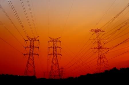 great sunset via electrical pylon tower          photo