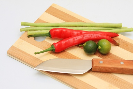 knife cut board and few vegetables Stock Photo - 10735264
