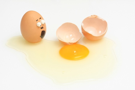 egg accident and breaked on solated white background