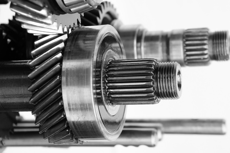 mechanical gear on isolated white background         photo