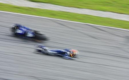 cornering: SEPANG, MALAYSIA - OCTOBER 21: Motion blur Katsuyuki Nakasuga from Yamaha Factory Racing fell while taking a corner during a Official Test at Sepang International Circuit, Malaysia on October 21, 2011.