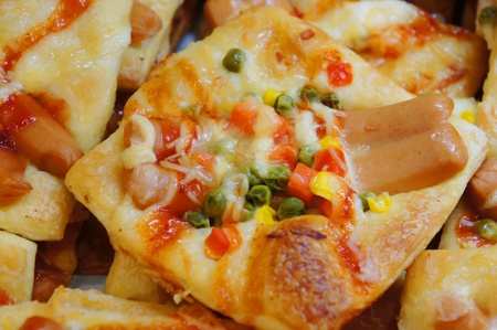 mini pizza: mini pizza with sauce and sausage  Stock Photo