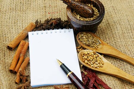 note book and herb cooking background Stock Photo