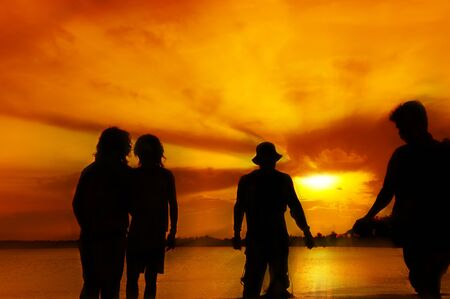 silhouette four man at beach on sunset photo
