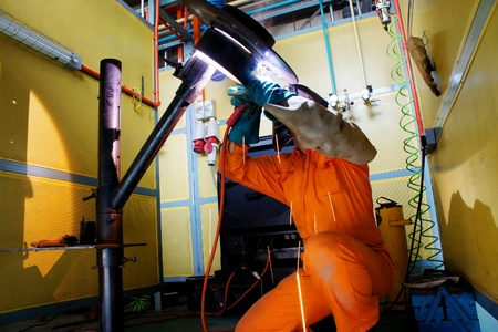 welder at work with safety procedure