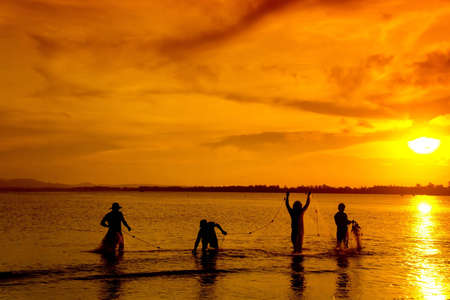 a group of traditional fisherman photo