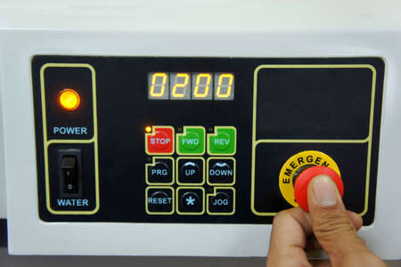 pushing emergency stop on cnc machine Stock Photo - 12701082
