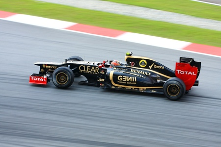SEPANG - MARCH 23: Romain Grosjean of Lotus Renault F1 races on training session on march 23 , 2012, in Sepang circuit, Malaysia