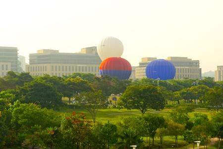 PUTRAJAYA, MALAYSIA-MARCH 18 :Variety of balloons take flight at the 4th Putrajaya International Hot Air Balloon Fiesta March 18, 2012 in Putrajaya.More than 300,000 people attended the event.