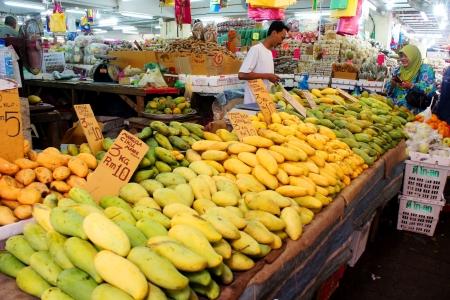 KUALA TERENGGANU,MALAYSIA-APR 16:Unidentified local fruits traders treat customers at Pasar Payang in K.Terengganu, April 16, 2012.This is a popular local market among tourist selling varieties of local food