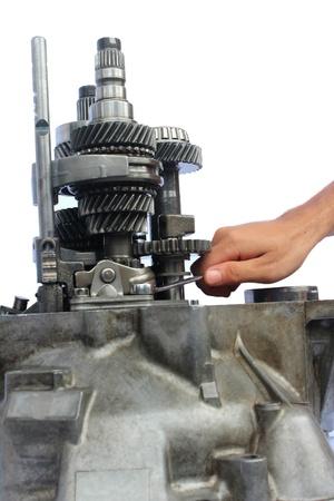 crankshaft: automotive gearbox repairing on isolated background