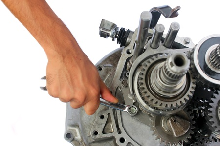 car transmission: automotive gearbox repairing on isolated background