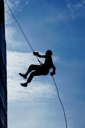 wall climber silhouette against bluesky Stock Photo - 15524064