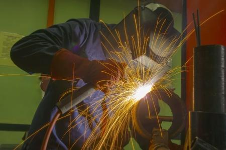 skillful: welder at work on indoor location