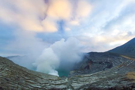 kawah ijen volcano with sulfur smoke