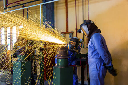 cutting pipe work with acetylene gas Stock Photo