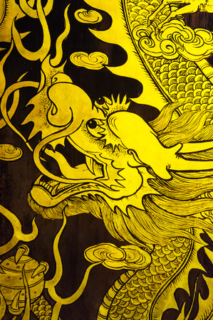 teng: golden dragon wall painting background Stock Photo
