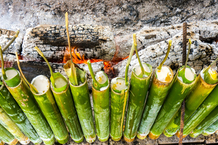 A row of traditional Malay food, lemang. Lemang is made of glutinous rice and cook in a bamboo sticks during eid celebration in Malaysia.