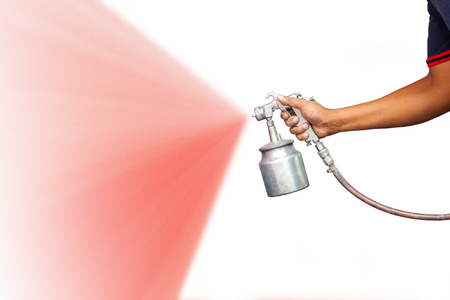 paint gun: hand holding spray gun on isolated background