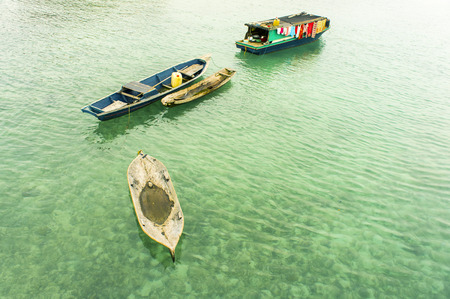 malaysia culture: bajau floating boat on clear water