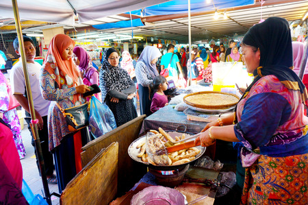 TERENGGANU, MSIA-JUNE 19: Vendor was frying keropok lekor at Pasar Kedai Payang, K Tganu on June 19, 2015 in Tganu, Malaysia. K Tganu town is a popular tourist destination in Malaysia