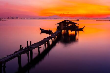 tradional: colorful sunrise with tradional fisherman jetty Stock Photo
