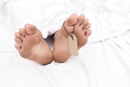 mortuary: Close up of human feet at the morgue